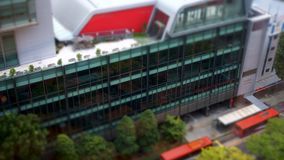 Singapore, August 7,2018 : 4K Tilt Shift Time lapse reflection of facade building with traffic stock footage