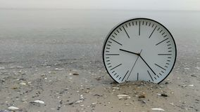 4K Time Concept Background, Clock in Water on Sand Beach Ocean and Sea Gulls on Horizon. Time Concept Background, White Wall Clock with Black Arrows on Sand stock footage