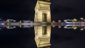 4K Time Lapse of Arc de Triomphe at night, Paris with mystic reflection. Wide angle Time Lapse of Arc de Triomphe at night, Paris, 4K, car trails with mystic stock footage
