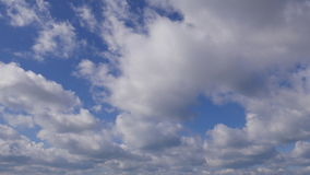 4K Time lapse clip of white fluffy clouds over blue sky, Running clouds stock video footage
