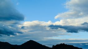 4K Time lapse of Clouds over hill stock video footage