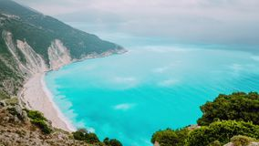 4k time lapse with flowing clouds above turquoise water surface of Myrtos beach, Kefalonia, Greece stock footage