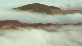 Inversion clouds on the forest. 4K Time-lapse inversion clouds on the edge of the forest in the background shows up village stock video
