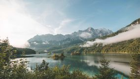 4K Time lapse of lake Eibsee in Bavaria Germany clouds during sunrise