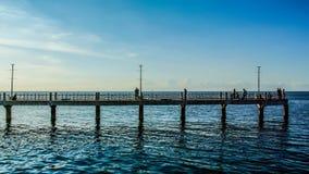 4K Time lapse of people fishing at bridge stock footage