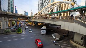 Public sky walk and traffic at Chong Nonsi sky train station, Bangkok, Thailand. 4k Time-lapse of public sky walk and traffic at Chong Nonsi sky train station stock video footage