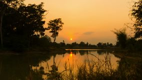 4K Time lapse scene sunset over lagoon. 4K Time lapse sunset scene over lagoon, incoming dark at Thailand countryside stock video