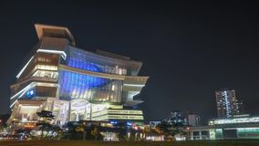 4k time lapse shot of modern urban architecture building in bright night city lights illumination in Singapore cityscape. Time lapse shot of modern urban stock video footage