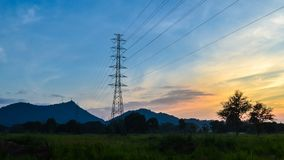 4K Time lapse of silhouette electricity pole with sunset sky background stock video footage