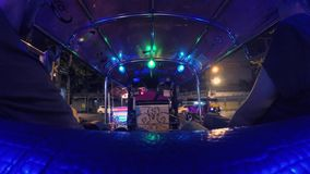 4K Time Lapse: Tourists Riding Tuk-Tuk driving at Night Streets. Popular Three-Wheeled Traditional Taxi Transport in. Asia. Bangkok, Thailand - 17 NOV 2017 stock video footage