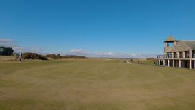 4k time lapse of two men teeing off at St Andrews Links Golf Course on a sunny day