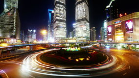 4k-Time lapse of urban traffic at night,Brightly lit shanghai pudong building. stock footage