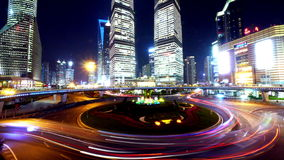 4k-time lapse,urban traffic at night,Brightly lit shanghai pudong building. stock footage