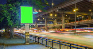 4K Time Lapse 4096x2160 : The traffic motion and green billboard with ProRes 422HQ Blur content. stock video