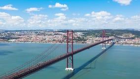 4K timelapse της γέφυρας 25 de Abril (Απρίλιος) στη Λισσαβώνα - την Πορτογαλία - UHD απόθεμα βίντεο