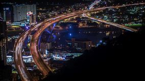 4K Timelapse aerial of highway bridge with busy traffic in nigth Taipei city stock video