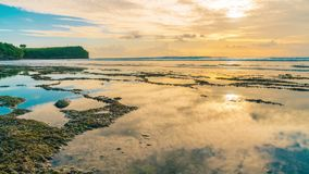 Timelapse of clouds reflecting in the water on the beach Balangan the island of Bali in Indonesia. stock footage