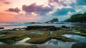 Sunset timelapse at the broken beach. In the distance one can see the temple of Tanah Lot on the island of Bali in. 4K Timelapse in Bali Island, indonesia stock footage