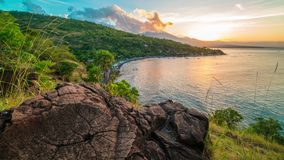 The sunset timelapse in Jemeluk Bay overlooking the Agung volcano in Bali, Indonesia. 4K Timelapse in Bali Island, indonesia stock footage