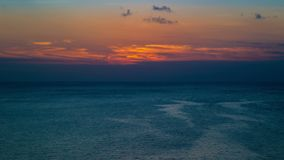 Time-lapse of the sun went over the horizon, fishing boats swam into the sea. stock video footage