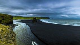 4K TimeLapse. A beautiful black sand beach Reynisdrangar - basalt columns, towering 70 meters above the waters of the. 4K TimeLapse - 15 June 2015, Reykjavik stock video footage