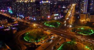 4k timelapse busy urban traffic on overpass at night,urban morden building,QingDao china. 4k timelapse busy urban traffic jam highway at night,Overpass stock video