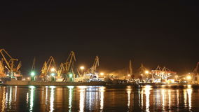 4K Timelapse, cargo ship moving load at port of Odessa. Night Time lapse stock footage