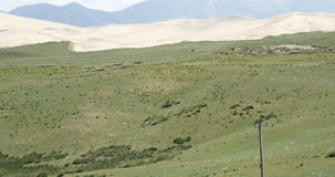 4k timelapse cloud shadow rolling over desert & grassland scenery,plateau. stock video footage