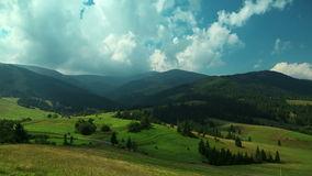 4K Timelapse of clouds and beautiful green fields stock video footage