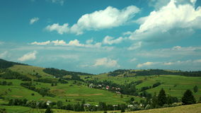 4K Timelapse of clouds and beautiful green fields stock footage