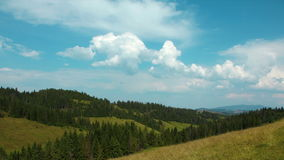 4K Timelapse of clouds and beautiful green mountains with coniferous trees stock footage