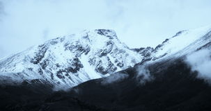 4k timelapse clouds mass rolling over Tibet snow-Covered mountains. stock footage