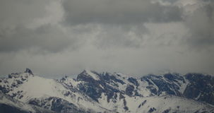 4k timelapse clouds mass rolling over Tibet snow-Covered mountains. stock video footage