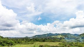 4K. Timelapse clouds over the green field. Tropical island Bali, Indonesia. Mountains on the background. 4K. Timelapse clouds over the green field. Tropical stock footage