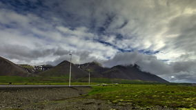 4K TimeLapse. Clouds over the mountains of volcanic ash and highway with cars. Iceland, 15 June 2015. 4K TimeLapse - 15 June 2015, Reykjavik, Iceland stock video footage