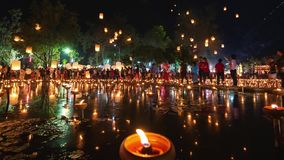 4K Timelapse of Floating lanterns and People in Yee Peng Festival or Loy Krathong celebration. At Nong Bua, San Kamphaeng, Chiang Mai, Thailand Zoom-In stock footage