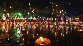 4K Timelapse of Floating lanterns and People in Yee Peng Festival or Loy Krathong celebration. At Nong Bua, San Kamphaeng, Chiang Mai, Thailand Zoom-Out stock video footage