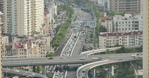 4k Time lapse busy urban traffic on overpass,urban morden building,china. 4k Timelapse of freeway busy city rush hour heavy traffic jam highway,Overpass stock video
