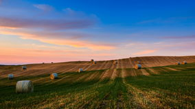 4K Timelapse of hay bales on the field at sunset, Tuscany, Italy stock video footage