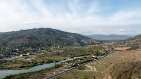 4K Timelapse of the highway with cars. Countryside city, river and mountains on the background. stock footage