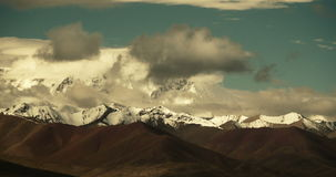 4k timelapse huge clouds mass rolling over lake namtso & snow mountain in tibet. stock video footage