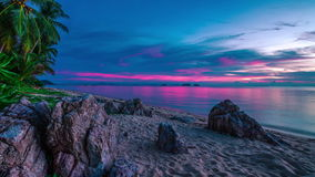 4K TimeLapse. Incredible violet sunset over the sea and rocky beach, Koh Samui, Thailand stock video footage