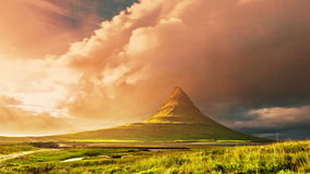 4K TimeLapse. Kirkjufell - mountain in the western part of Iceland, located near Grundarfjordur. Sunset with running stock video footage
