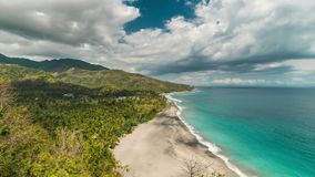 Timelapse Tropical sandy beach with palm trees at sunny day at the Lombok island, Indonesia. 4K Timelapse in Lombok Island, Indonesia stock video