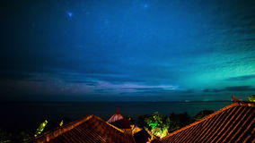 4K Timelapse. The Milky Way above the roofs of bungalows and Indian Ocean. 15 July 2015, Bali, Indonesia stock footage