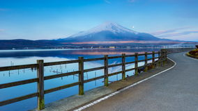 4K Timelapse of Moon set and Sun rise over Mt. Fuji at Yamanaka lake , Japan stock video