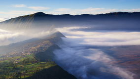 4K Timelapse of morning mist at Cemoro Lawang village, Bromo volcano, Indonesia stock video