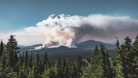 4K Timelapse movie video film of Smoke caused by Large Brush Fire Wide Shot in Oregon, Crater Lake National Park. 4k