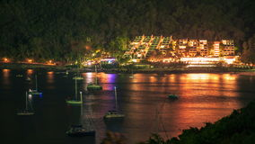 4K TimeLapse. Night view of the floating yachts and glowing hotel on the slope of the tropical mountain of Phuket. 4K TimeLapse - December and January 2016 stock video footage