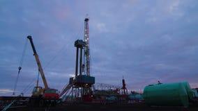 4K Timelapse oil drilling rig evening. Timelapse oil gas drilling rig evening stock video